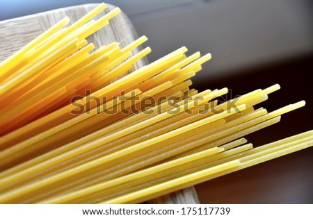 close up of uncooked spaghetti on wood, italin ingredient