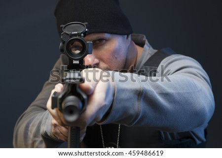 Close up of Undercover Law Enforcement Special Agent with weapon and optic. - stock photo
