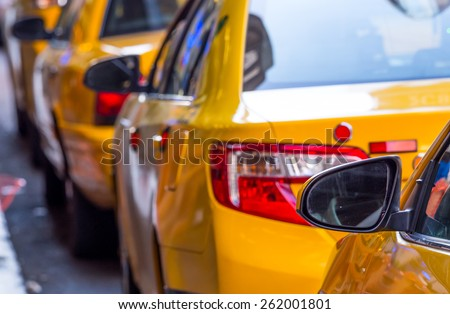 close up of unidentified yellow cab in Manhattan - stock photo