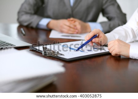 Close up  of unknown  business people at meeting discussing financial results