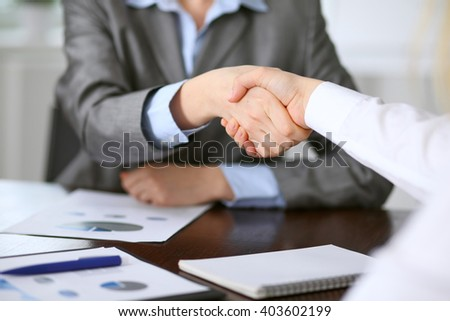 Close up  of unknown  business people handshake