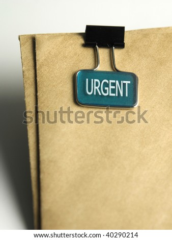 close up of urgent clip on the document - stock photo