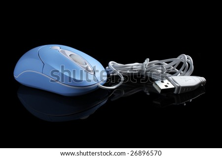 Close up of USB optical mouse isolated on black background.