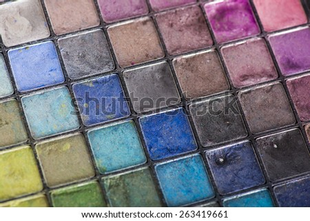 Close Up of Used Eye Shadow Make Up Palette in a Variety of Colorful Hues - stock photo