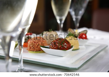 Close up of various appetizer between glasses - stock photo