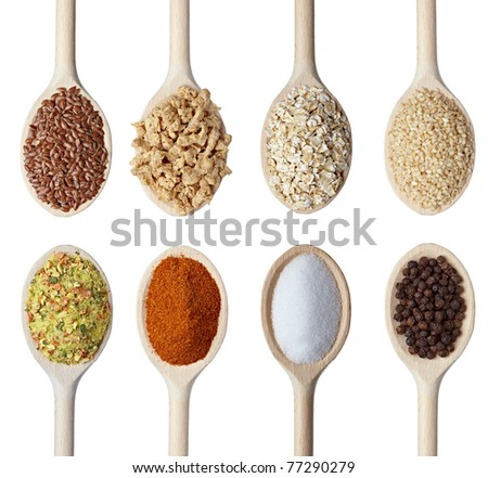 close up of various cereals and seasoning in wooden spoons on white background. each one is shot separately