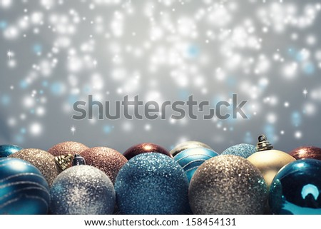 close up of various christmas balls on blue background - stock photo