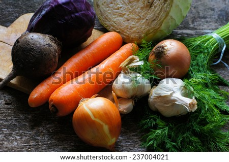 Close up of various colorful raw vegetables on the wooden table - stock photo
