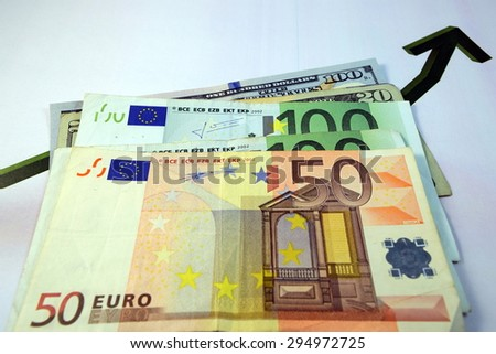 Close up of  Various currency notes and coins from different countries - stock photo