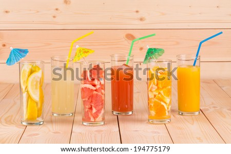 Close up of various juices on wood table. Wooden background.