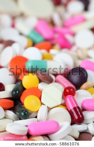 Close-up of various kinds of pills and capsules. Shallow dof - stock photo
