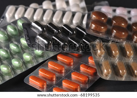 close up of various types of tablets - stock photo
