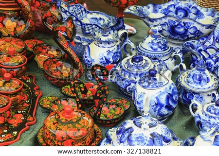 close-up of various utensils painted in the style of Gzhel and Khokhloma handmade - stock photo