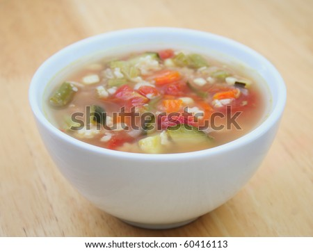 Close Up of Vegetable Soup in a White Bowl - stock photo