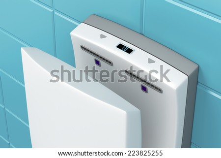 Close-up of vertical hand dryer in public WC - stock photo