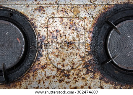 Close up of very dirty gas burner in the kitchen - stock photo
