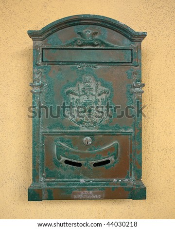 Close-up of very old green mailbox