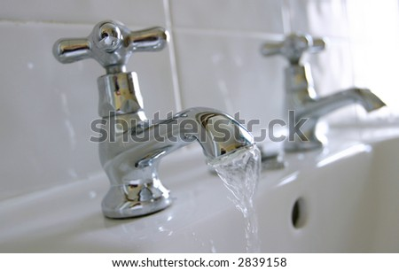 Close-up of Victorian-style basin taps - stock photo