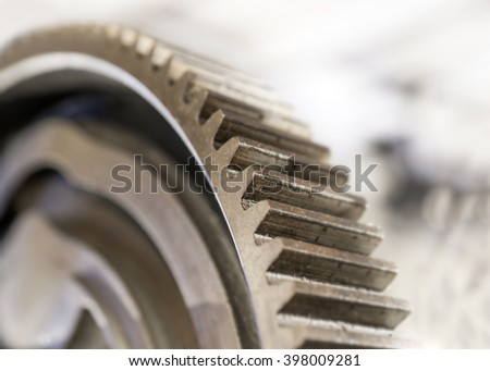 close up of vintage cogwheel on blurred background - stock photo