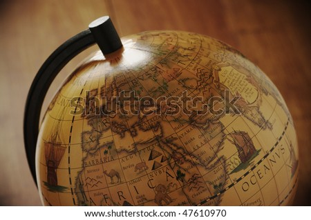 Close-up of vintage globe in back light. - stock photo