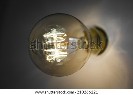 Close up of vintage glowing light bulb - stock photo