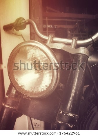 Close up of vintage motorcycle headlights - stock photo
