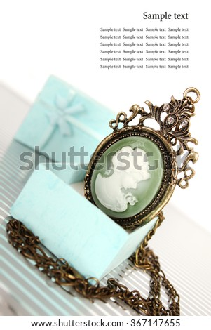 Close-up of vintage pendant in gift box - stock photo