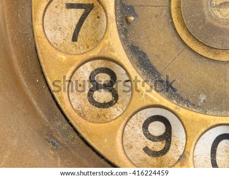 Close up of Vintage phone dial, dirty and scratched - 8 - stock photo