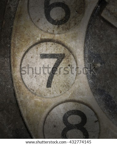 Close up of Vintage phone dial, dirty and scratched - 7 - stock photo