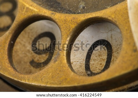 Close up of Vintage phone dial, dirty and scratched - 0, perspective - stock photo