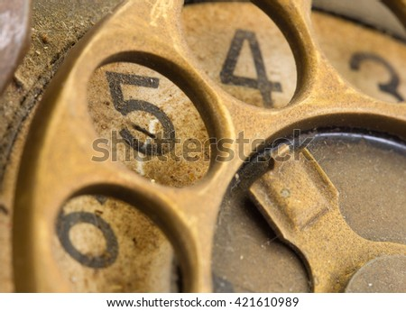 Close up of Vintage phone dial, dirty and scratched - 5, perspective - stock photo