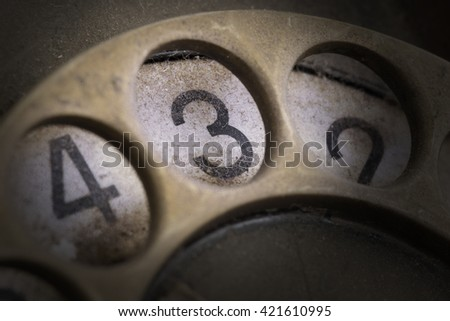 Close up of Vintage phone dial, dirty and scratched - 3, perspective - stock photo