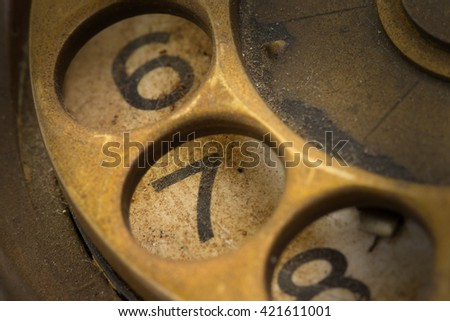 Close up of Vintage phone dial, dirty and scratched - 7, perspective - stock photo