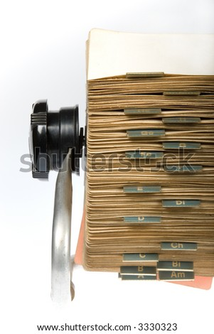 Close-up of vintage rotary card file holder on white background - stock photo