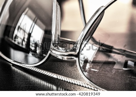 close up of vintage sunglasses in black and white