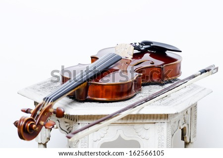 Close-up Of Vintage Violin on the wooden white table - stock photo