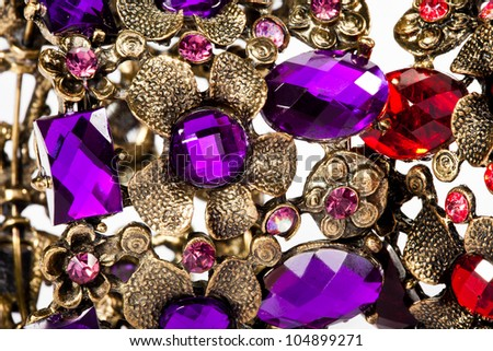 Close-up of violet and red bracelet - stock photo