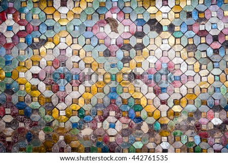 close up of wall is decorated with old stained glass small plate traditional thai old mosaic