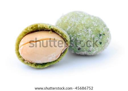 Close up of wasabi peanut snack balls isolated over white background.