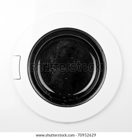 Close-up of washing machine door. In B/W - stock photo