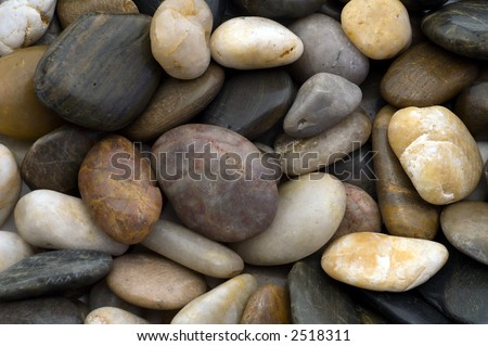 Close up of water eroded stones filling frame - landscape orientation - stock photo