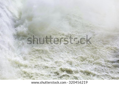 Close up of water spray power. Big waves of ocean, Drops of water in waterfall. Water power station - stock photo