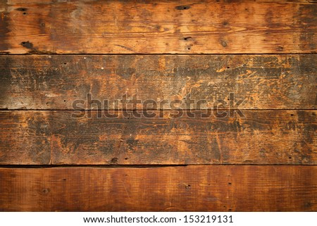 close up of  weathered and textured boards on an old wooden farm door - stock photo