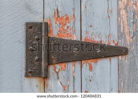 Close up of Weathered Antique Barn Hinge - stock photo