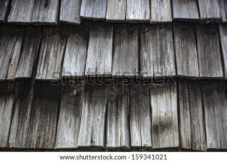 Close up of Weathered Cedar Shingles on roof - stock photo