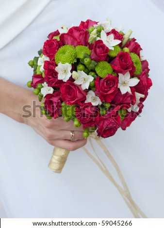 close-up of wedding bouquet at bride's hands - stock photo