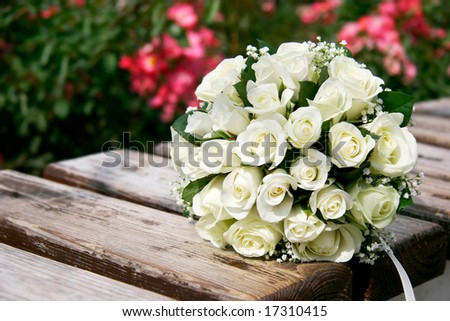 close up of wedding bouquet on wooden bench - stock photo