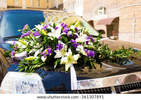 Close-up of Wedding Car Decorated with Flowers