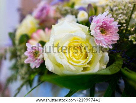 Close up of Wedding flowers set up in catholic church. - stock photo