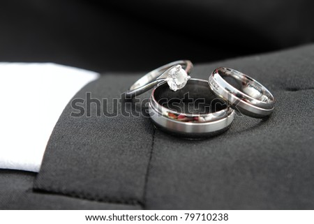 Close-Up Of Wedding Rings And Engagement Ring - stock photo